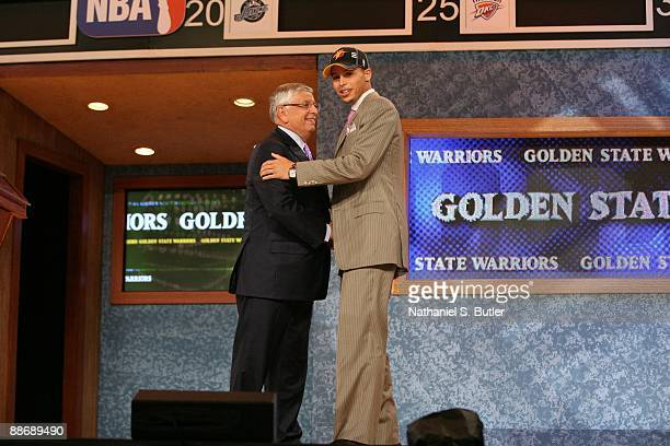 Stephen Curry shakes hands with NBA Commissioner David Stern after being selected seventh by the Golden State Warriors during the 2009 NBA Draft on...