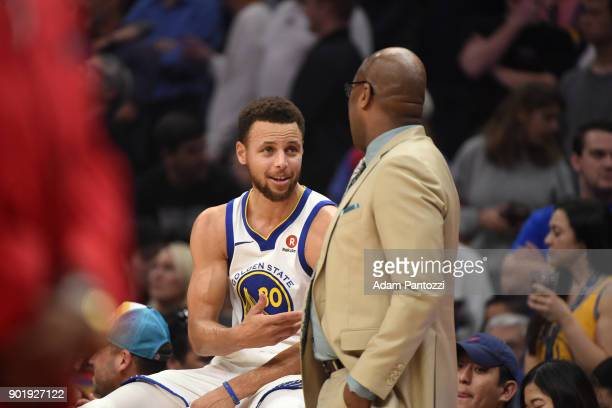 Stephen Curry speaks to Assistant Coach Mike Brown during the game against the LA Clippers on January 6 2018 at STAPLES Center in Los Angeles...
