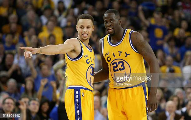 Stephen Curry talks to Draymond Green of the Golden State Warriors during their game against the Washington Wizards at ORACLE Arena on March 29 2016...