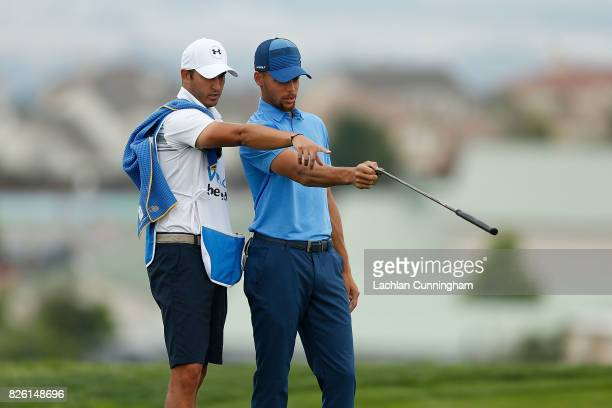 Stephen Curry talks to his caddy Jonnie West before playing a shot during round one of the Ellie Mae Classic at TCP Stonebrae on August 3 2017 in...