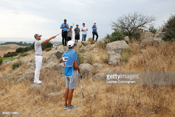 Stephen Curry talks with his caddie Jonnie West on the eighth hole during round two of the Ellie Mae Classic at TCP Stonebrae on August 4 2017 in...