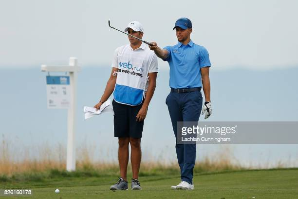 Stephen Curry talks with his caddie Jonnie West on the sixteenth hole during round one of the Ellie Mae Classic at TCP Stonebrae on August 3 2017 in...