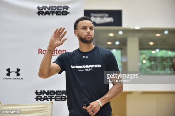 Stephen Curry, US basketball player from the Golden State Warriors of the National Basketball Association , waves to fans before a press conference...