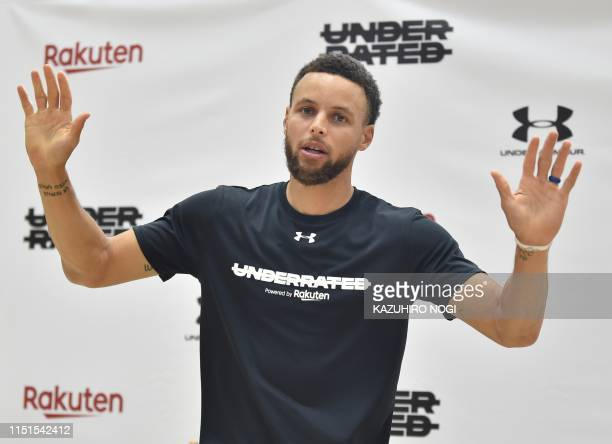 Stephen Curry, US basketball player from the Golden State Warriors of the National Basketball Association , gestures during a press conference...