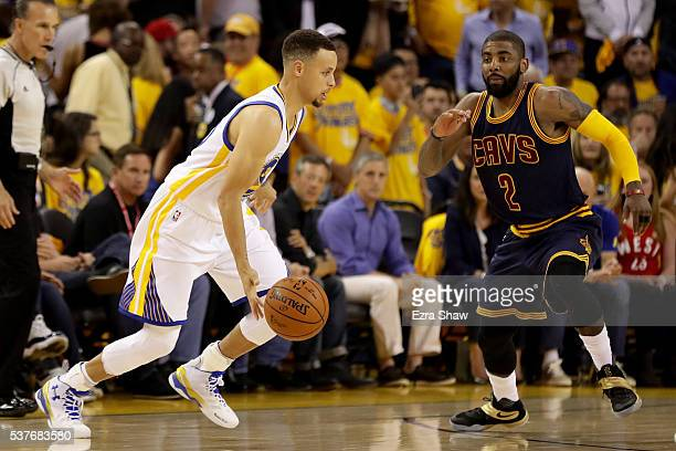 Stephen Curry wof the Golden State Warriors ith the ball against Kyrie Irving of the Cleveland Cavaliers in the first half in Game 1 of the 2016 NBA...
