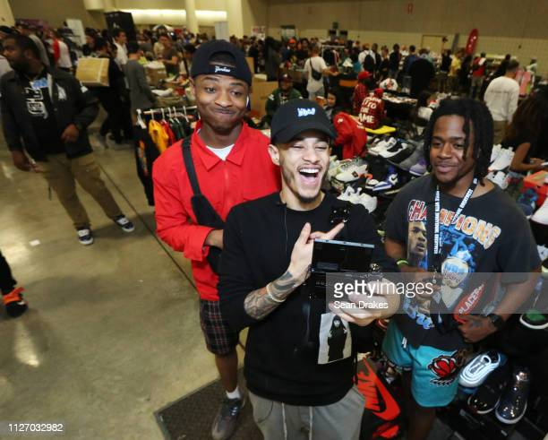 Stephen Dabreo of New York City live streams his interview with Brian Felder and Malik Bodison of South Carolina during SneakerCon 2019 at Fort...