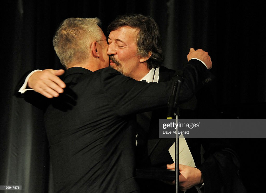 Stephen Daldry accepts an award from Stephen Fry at the 58th London Evening Standard Theatre Awards in association with Burberry at The Savoy Hotel on November 25, 2012 in London, England.