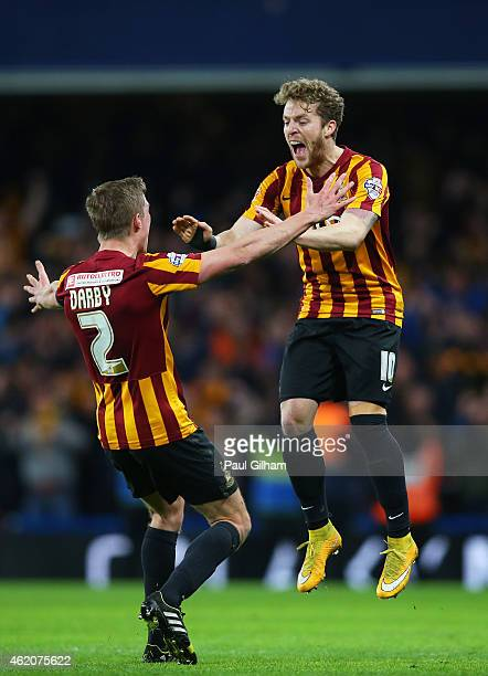 Stephen Darby of Bradford City and Billy Clarke of Bradford City celerate following their team's 42 victory during the FA Cup Fourth Round match...