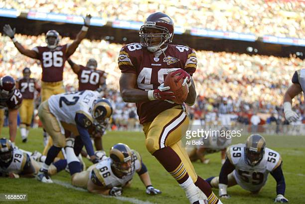 Stephen Davis of the Washington Redskins scores his 3rd touchdown of the day against the St Louis Rams on November 24 2002 at FedEx Field in Landover...