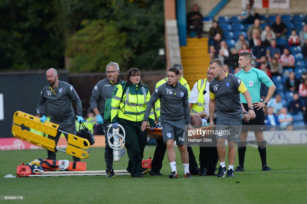 Stephen Dawson of Bury is stretchered off during the Carabao Cup First Round match between Bury and Sunderland at Gigg Lane on August 10, 2017 in Bury, England.