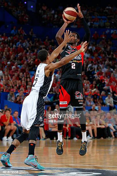 Stephen Dennis of United tries to block DeAndre Daniels of the Wildcats during the round 15 NBL match between the Perth Wildcats and Melbourne United...