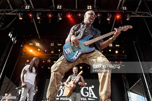Stephen 'Di Genius' McGregor Carl Young and Michael Franti of Michael Franti Spearhead perform in the crowd on April 17 2016 in Fort Lauderdale...