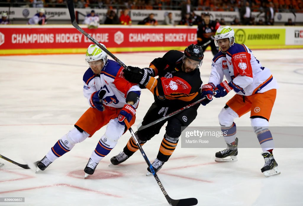 Stephen Dixon (R) of Wolfsburg and Juhani Jasu of Tampere battle for the puck during the Champions Hockey League match between Grizzlys Wolfsburg and Tappara Tampere at Eis Arena Wolfsburg on August 27, 2017 in Wolfsburg, Germany.