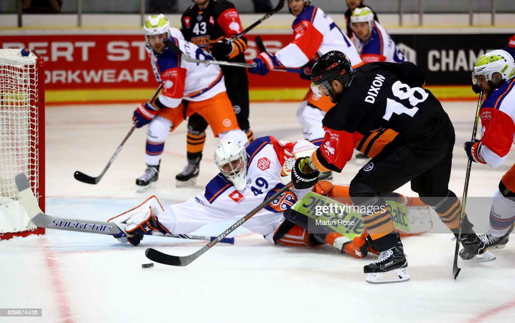 Stephen Dixon (R) of Wolfsburg fails to socre over Dominik Hrachovina, goaltender of Tampere during the Champions Hockey League match between Grizzlys Wolfsburg and Tappara Tampere at Eis Arena Wolfsburg on August 27, 2017 in Wolfsburg, Germany.