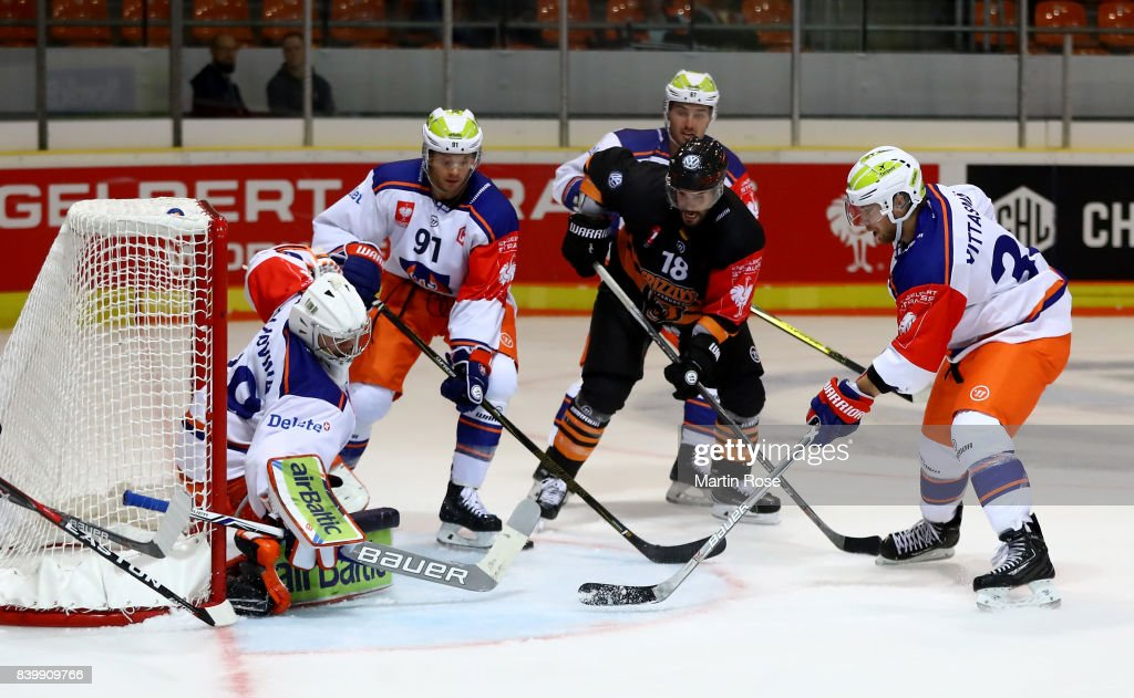 Stephen Dixon (C) of Wolfsburg fails to socre over Dominik Hrachovina, goaltender of Tampere during the Champions Hockey League match between Grizzlys Wolfsburg and Tappara Tampere at Eis Arena Wolfsburg on August 27, 2017 in Wolfsburg, Germany.