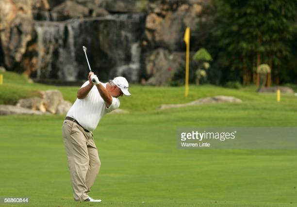 Stephen Dodd of Wales plays his second shot into the 17th green during the first round of the Maybank Malaysian Open 2006 at Kuala Lumpur Golf and...