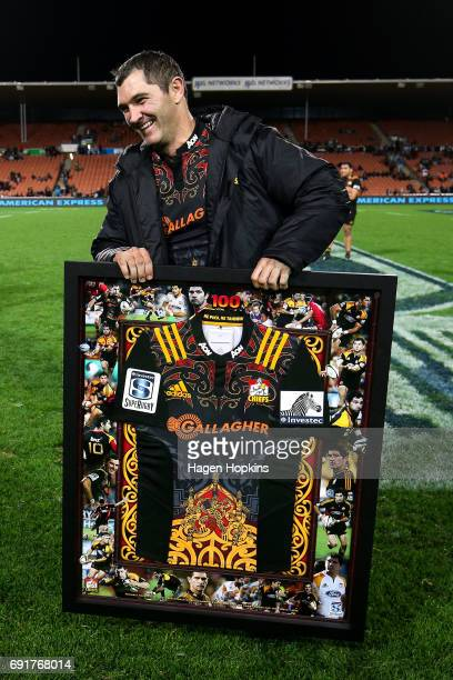 Stephen Donald is all smiles after being presented with a commemorative jersey in recognition of his 100th game for the Chiefs during the round 15...