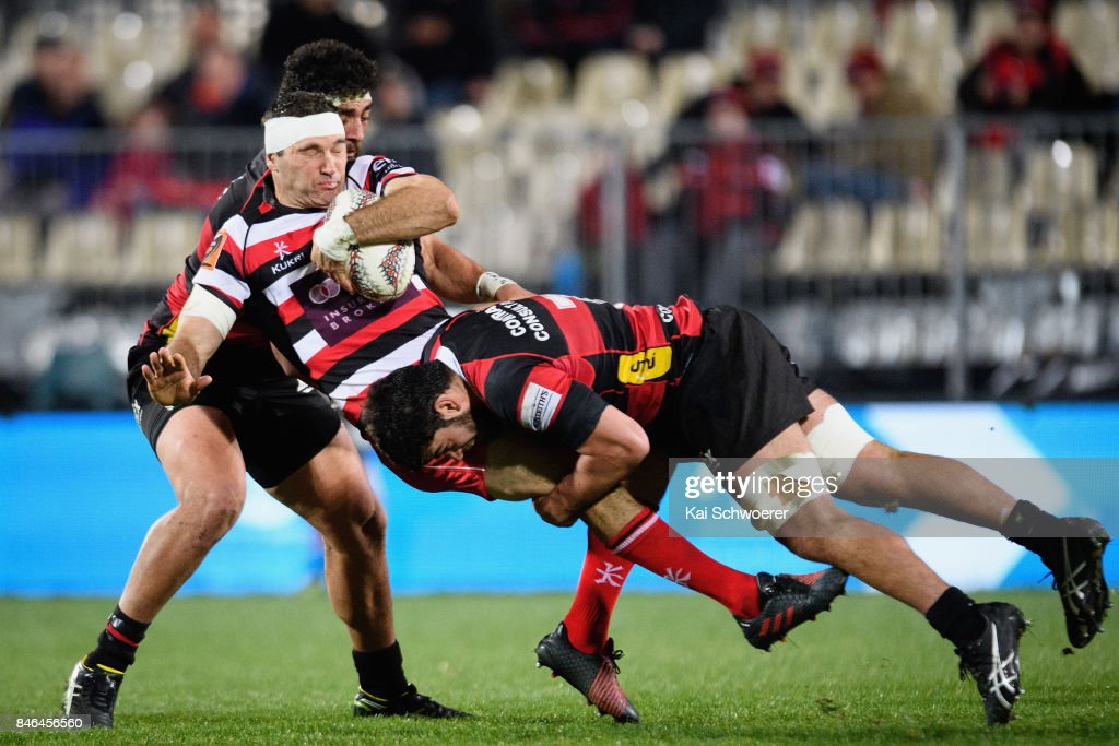 Stephen Donald of Counties Manukau is tackled by Billy Harmon of Canterbury during the round five Mitre 10 Cup match between Canterbury and Counties Manukau on September 13, 2017 in Christchurch, New Zealand.