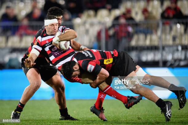 Stephen Donald of Counties Manukau is tackled by Billy Harmon of Canterbury during the round five Mitre 10 Cup match between Canterbury and Counties...
