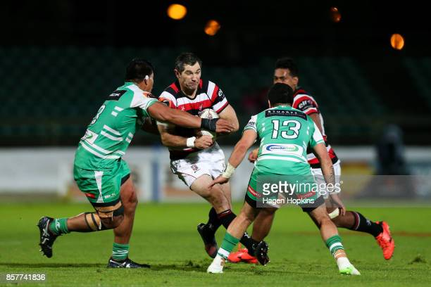 Stephen Donald of Counties Manukau runs at Michael Alaalatoa and Lewis Marshall of Manawatu during the round eight Mitre 10 Cup match between...