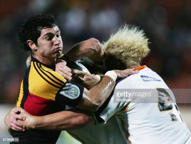 Stephen Donald of the Chiefs is tackled by Kobus Grobbelaar of the Cheetahs during the Round 11 Super 14 match between the Chiefs and the Cheetahs at...