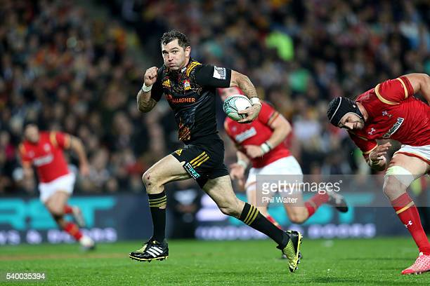 Stephen Donald of the Chiefs makes a break during the International Test match between the Chiefs and Wales at Waikato Stadium on June 14 2016 in...