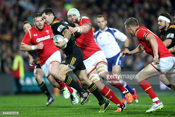 Stephen Donald of the Chiefs makes a break to set up the opening try during the International Test match between the Chiefs and Wales at Waikato...