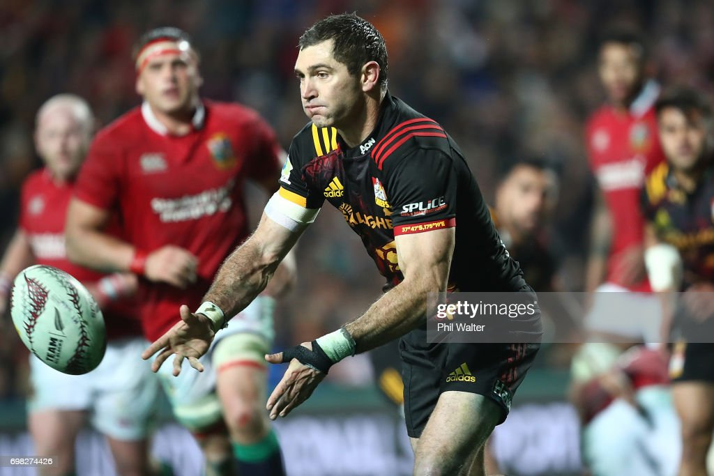 Stephen Donald of the Chiefs offloads during the match between the Chiefs and the British & Irish Lions at Waikato Stadium on June 20, 2017 in Hamilton, New Zealand.