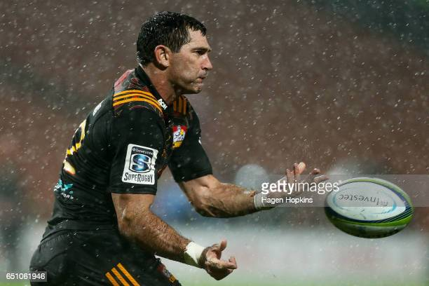 Stephen Donald of the Chiefs passes during the round three Super Rugby match between the Chiefs and the Hurricanes at FMG Stadium Waikato on March 10...