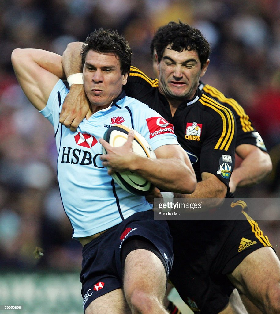 Stephen Donald of the Chiefs (R) tackles Ben Jacobs of the Waratahs during the round two Super 14 match between the Chiefs and the NSW Waratahs at Waikato Stadium on February 23, 2008 in Hamilton, New Zealand.