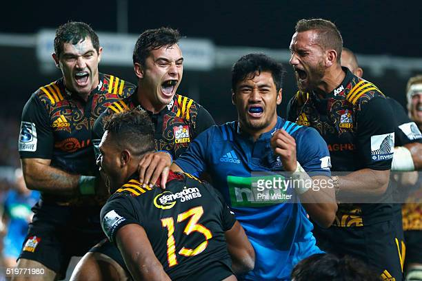 Stephen DonaldJames Lowe and Aaron Cruden celebrate the try from Seta Tamanivalu during the round seven Super Rugby match between the Chiefs and the...