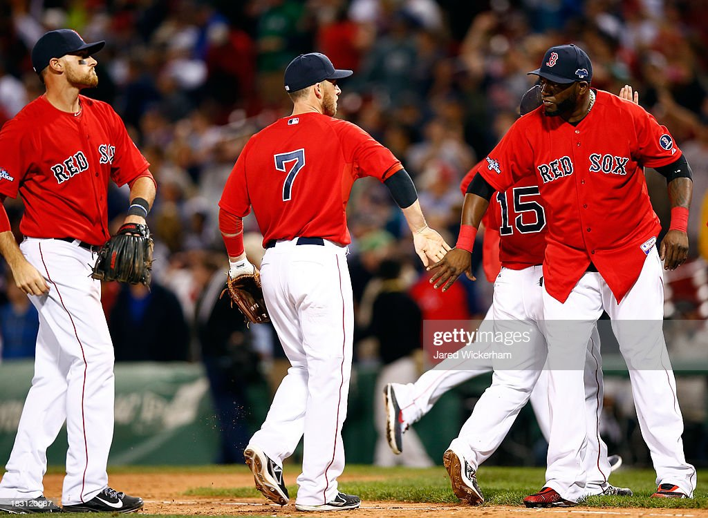 Stephen Drew #7 and David Ortiz #34 of the Boston Red Sox celebrate after defeating the Tampa Bay Rays 12-2 in Game One of the American League Division Series at Fenway Park on October 4, 2013 in Boston, Massachusetts.