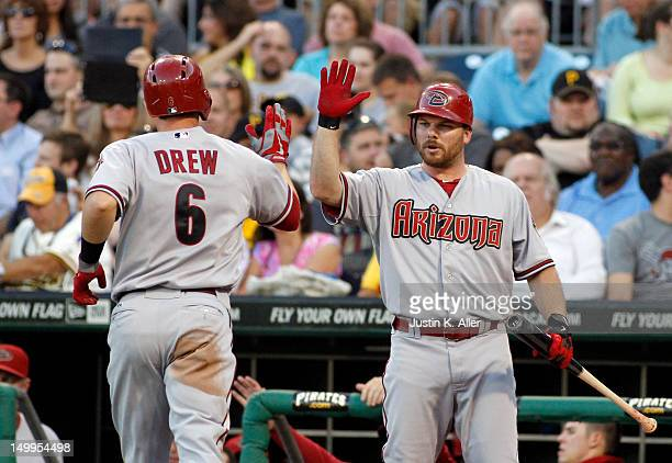 Stephen Drew of the Arizona Diamondbacks celebrates after hitting a solo home run in the third inning against the Pittsburgh Pirates during the game...