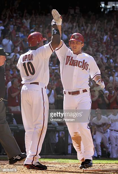 Stephen Drew of the Arizona Diamondbacks is congratulated by teammate Justin Upton after hitting a 2 run inside the park home run against the San...