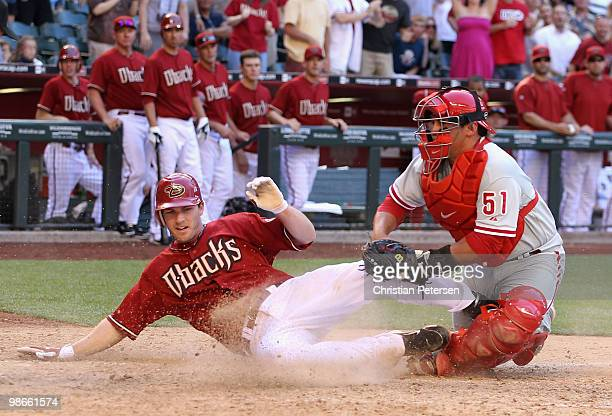 Stephen Drew of the Arizona Diamondbacks is tagged out at home plate by catcher Carlos Ruiz of the Philadelphia Phillies during the eighth inning of...