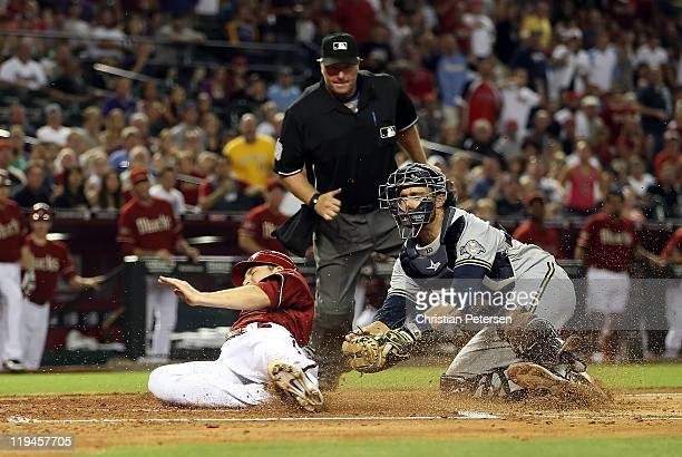 Stephen Drew of the Arizona Diamondbacks is tagged out by catcher Jonathan Lucroy of the Milwaukee Brewers as he attempts to score during the fifth...