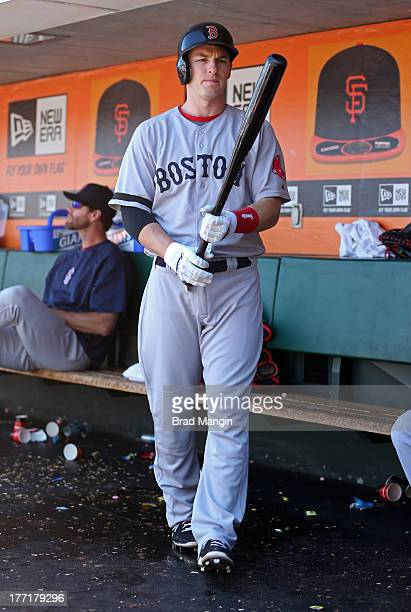 Stephen Drew of the Boston Red Sox gets ready for his next at bat in the dugout against the San Francisco Giants during the game at ATT Park on...