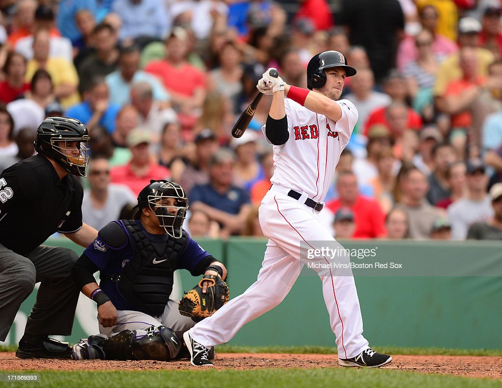 Stephen Drew #7 of the Boston Red Sox hits a triple against the Colorado Rockies in the sixth inning on June 26, 2013 at Fenway Park in Boston, Massachusetts.