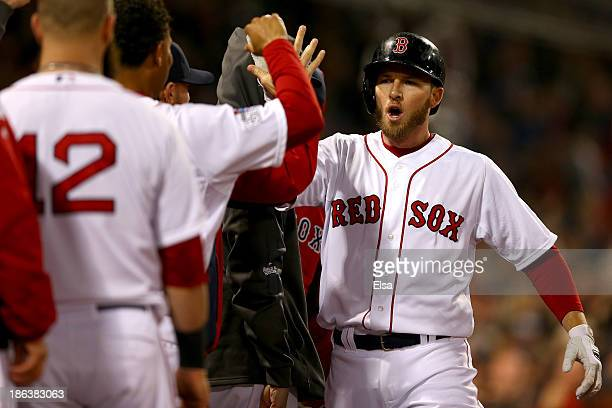 Stephen Drew of the Boston Red Sox returns to the dugout after hitting a home run in the fourth inning against the St Louis Cardinals during Game Six...