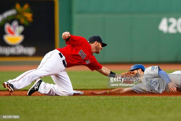 Stephen Drew of the Boston Red Sox tags out Eric Hosmer of the Kansas City Royals in the first inning on an attempted steal during the game at Fenway...