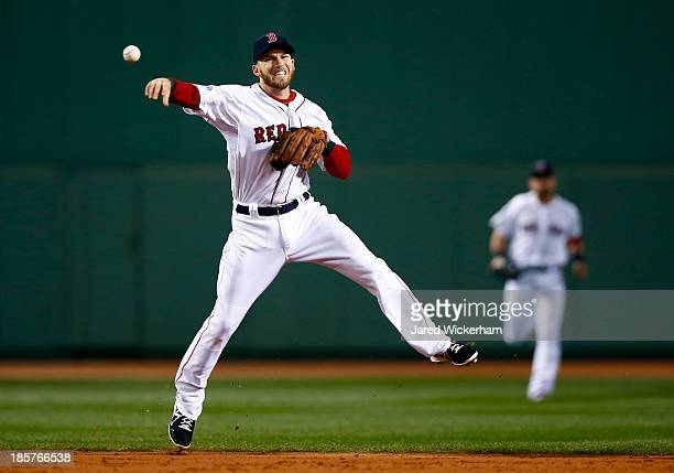 Stephen Drew of the Boston Red Sox throws the ball to first base against the St Louis Cardinals during Game Two of the 2013 World Series at Fenway...