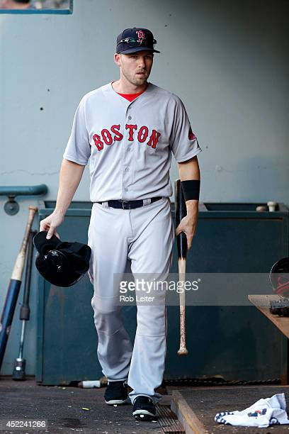 Stephen Drew of the Boston Red Sox walks in the dugout before the game against the Seattle Mariners at Safeco Field on June 24 2014 in Seattle...