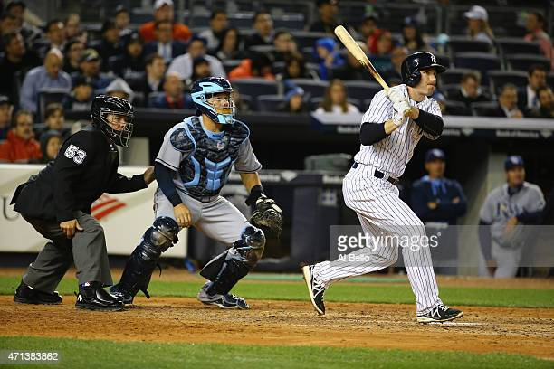 Stephen Drew of the New York Yankees drives in a run with a double against the Tampa Bay Rays in the sixth inning during their game at Yankee Stadium...