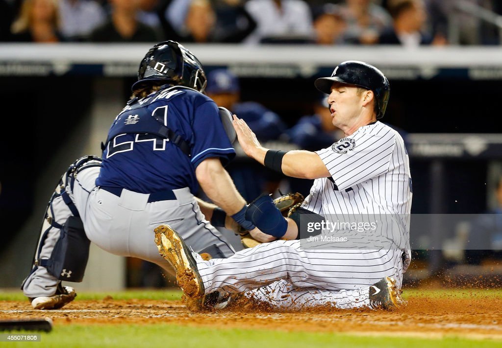 Stephen Drew #33 of the New York Yankees is tagged out at home by Ryan Hanigan #24 of the Tampa Bay Rays during the fifth inning at Yankee Stadium on September 9, 2014 in the Bronx borough of New York City.