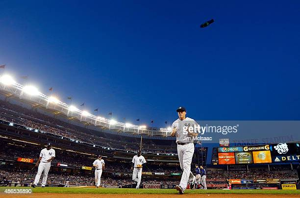 Stephen Drew of the New York Yankees leads his teammates off the field after the second inning against the Tampa Bay Rays at Yankee Stadium on...