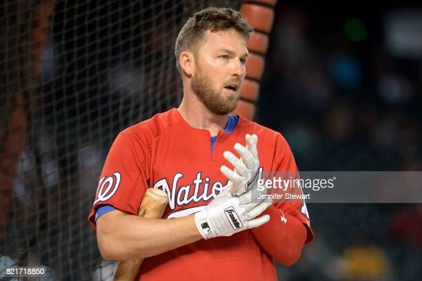 Stephen Drew of the Washington Nationals adjusts his Franklin batting gloves during batting practice for the MLB game against the Arizona...