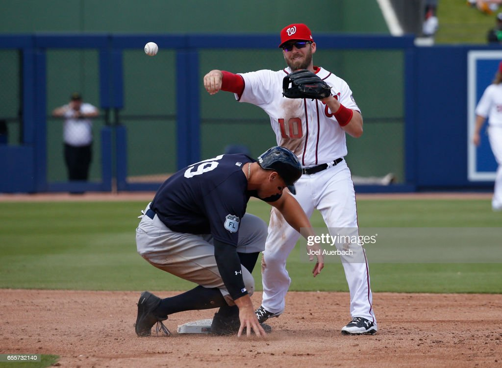 Stephen Drew #10 of the Washington Nationals gets Aaron Judge #99 of the New York Yankees out at second base but can't complete the double play in the third inning during a spring training game at The Ballpark of the Palm Beaches on March 20, 2017 in West Palm Beach, Florida. The Yankees defeated the Nationals 9-3.