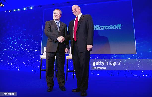 Stephen Elop chief executive officer of Nokia Oyj left shakes hands with Steve Ballmer chief executive officer of Microsoft Corp while on stage at...
