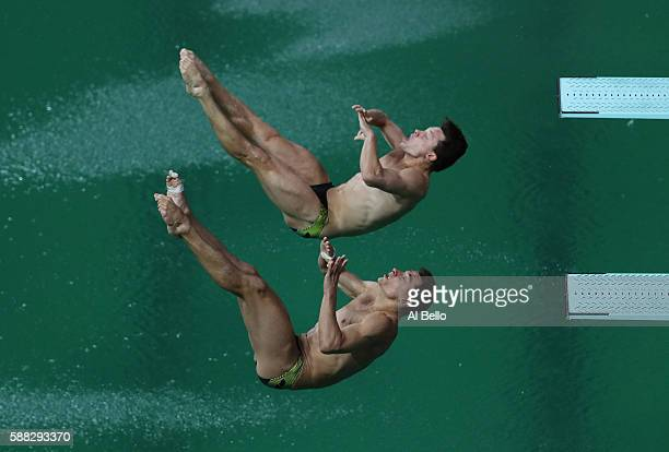 Stephen Feck and Patrick Hausding of Germany compete in the Men's Diving Synchronised 3m Springboard Final on Day 5 of the Rio 2016 Olympic Games at...
