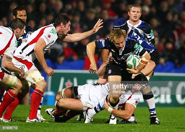Stephen Ferris of Ulster challenges Nick Abendanon of Bath during the Heineken Cup pool Four match between Ulster and Bath held at Ravenhill on...